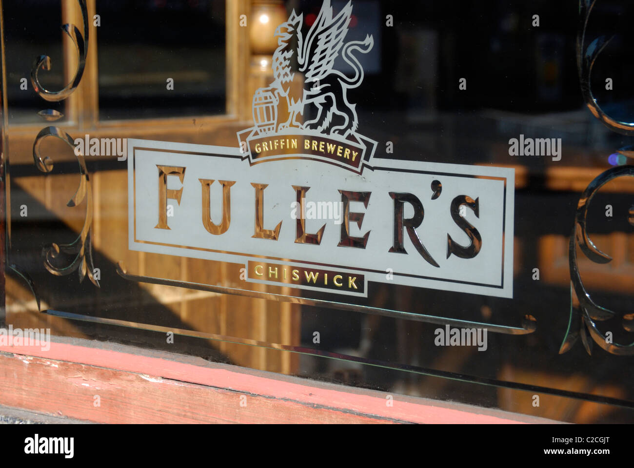 Fuller's brewery sign on a pub window - Stock Image