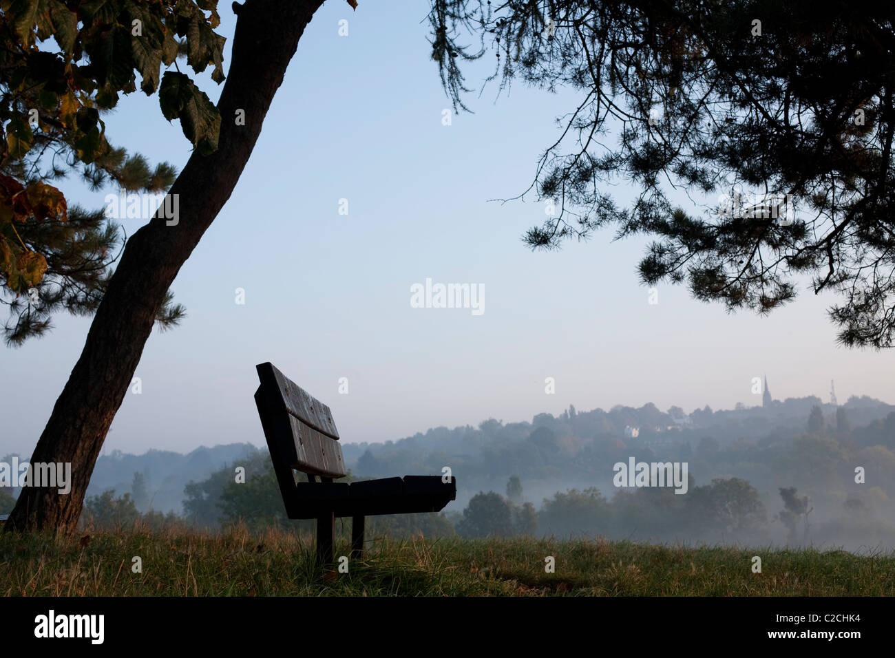 A bench in Hampstead Heath. - Stock Image