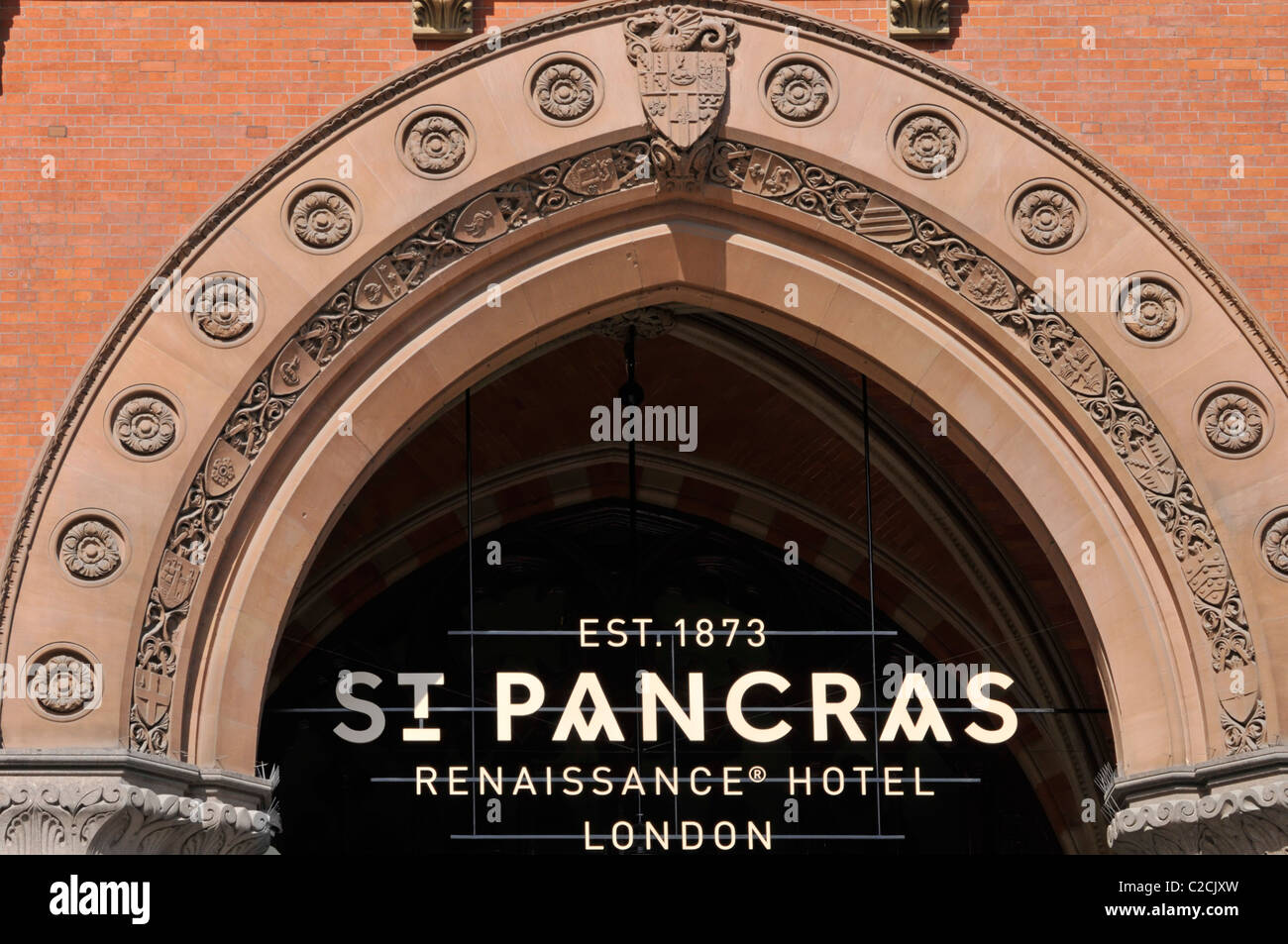 St Pancras Renaissance luxury five star hotel entrance arch & sign in the refurbished Victorian now Euro Star - Stock Image