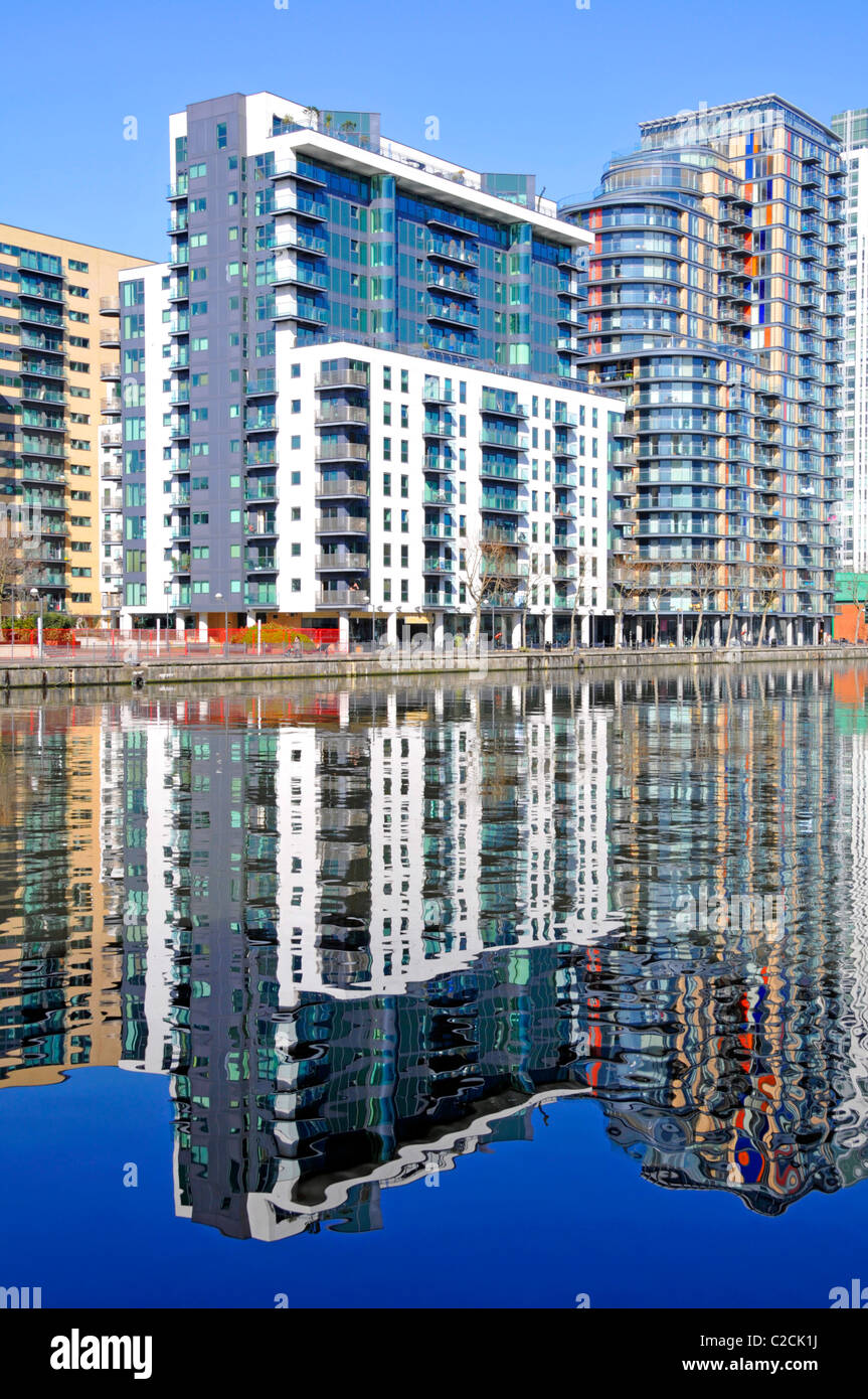 Waterside high rise apartment developments part of regeneration of Millwall Docks close to Canary Wharf - Stock Image