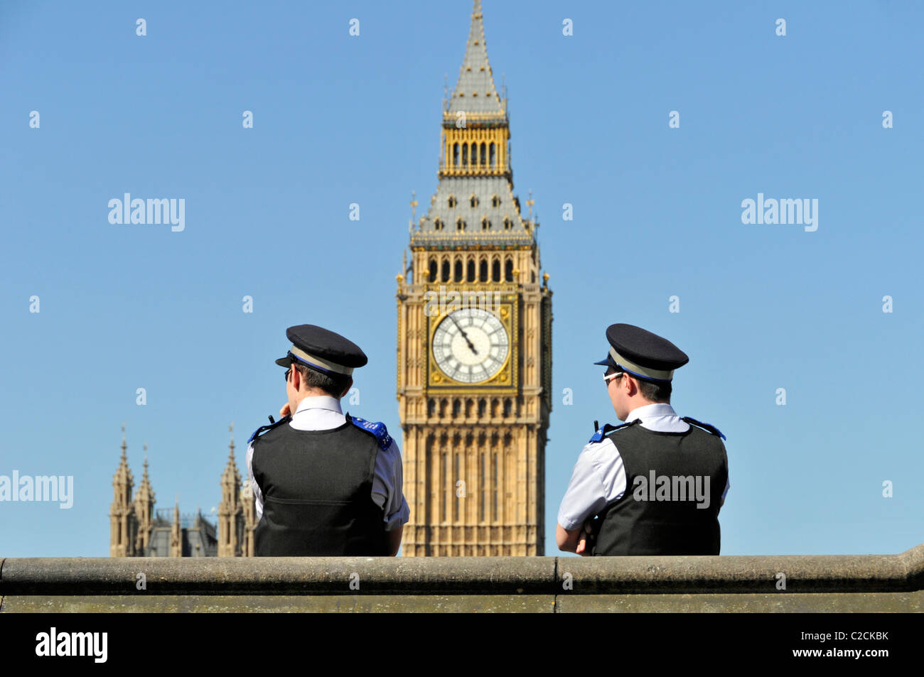Two community support officers with Big Ben beyond - Stock Image