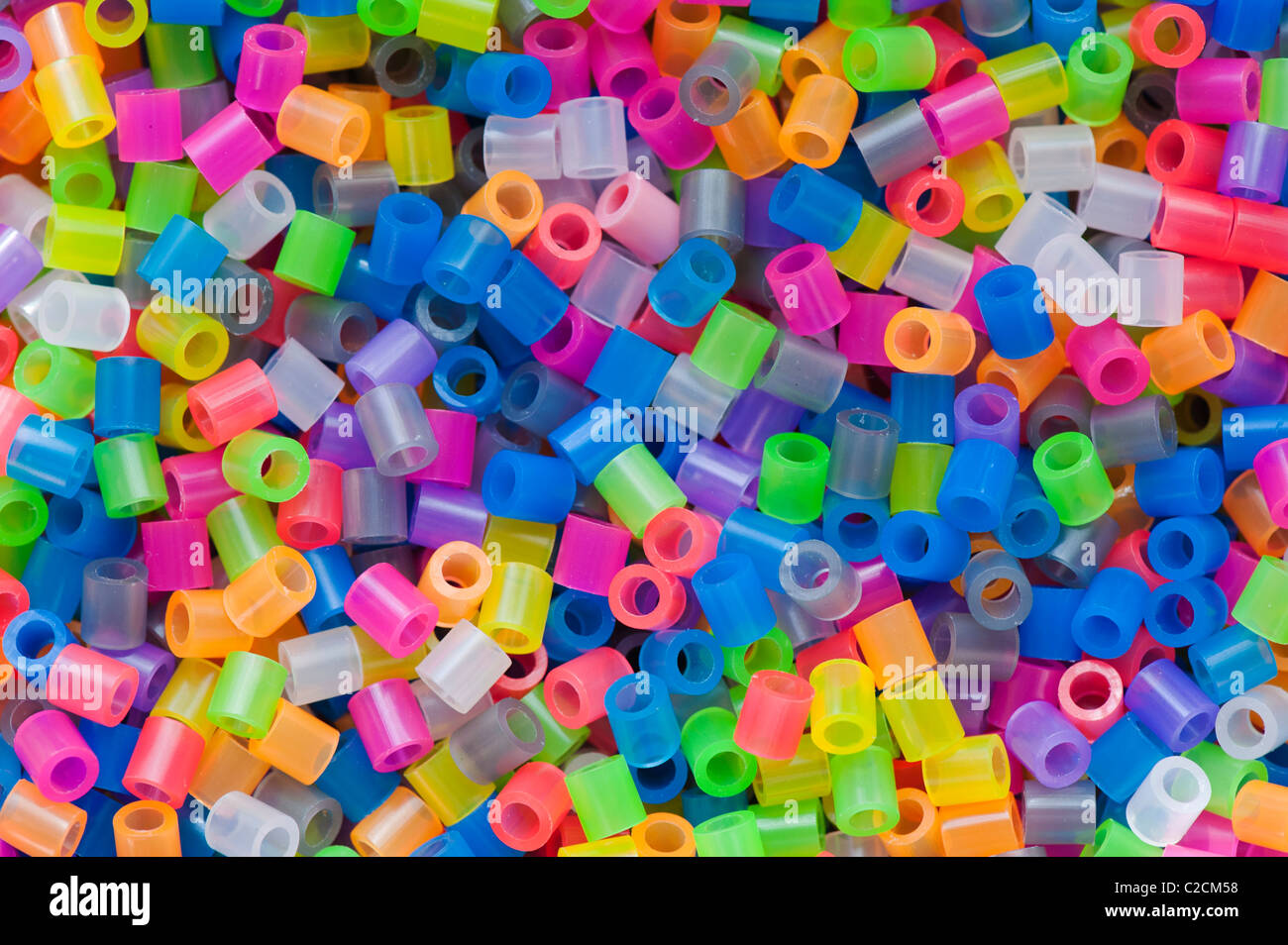 Multicoloured replica Hama plastic beads - Stock Image