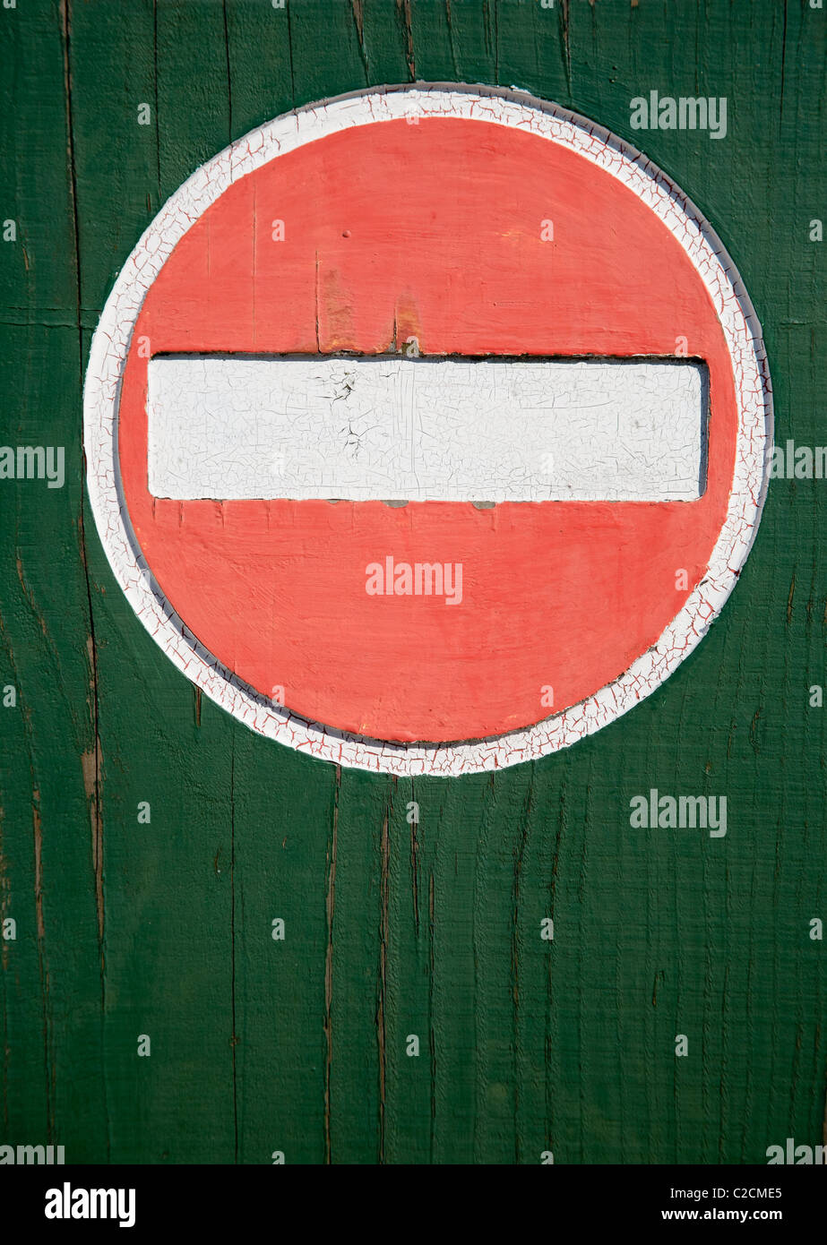 No entry sign made of wood on a green back ground - Stock Image