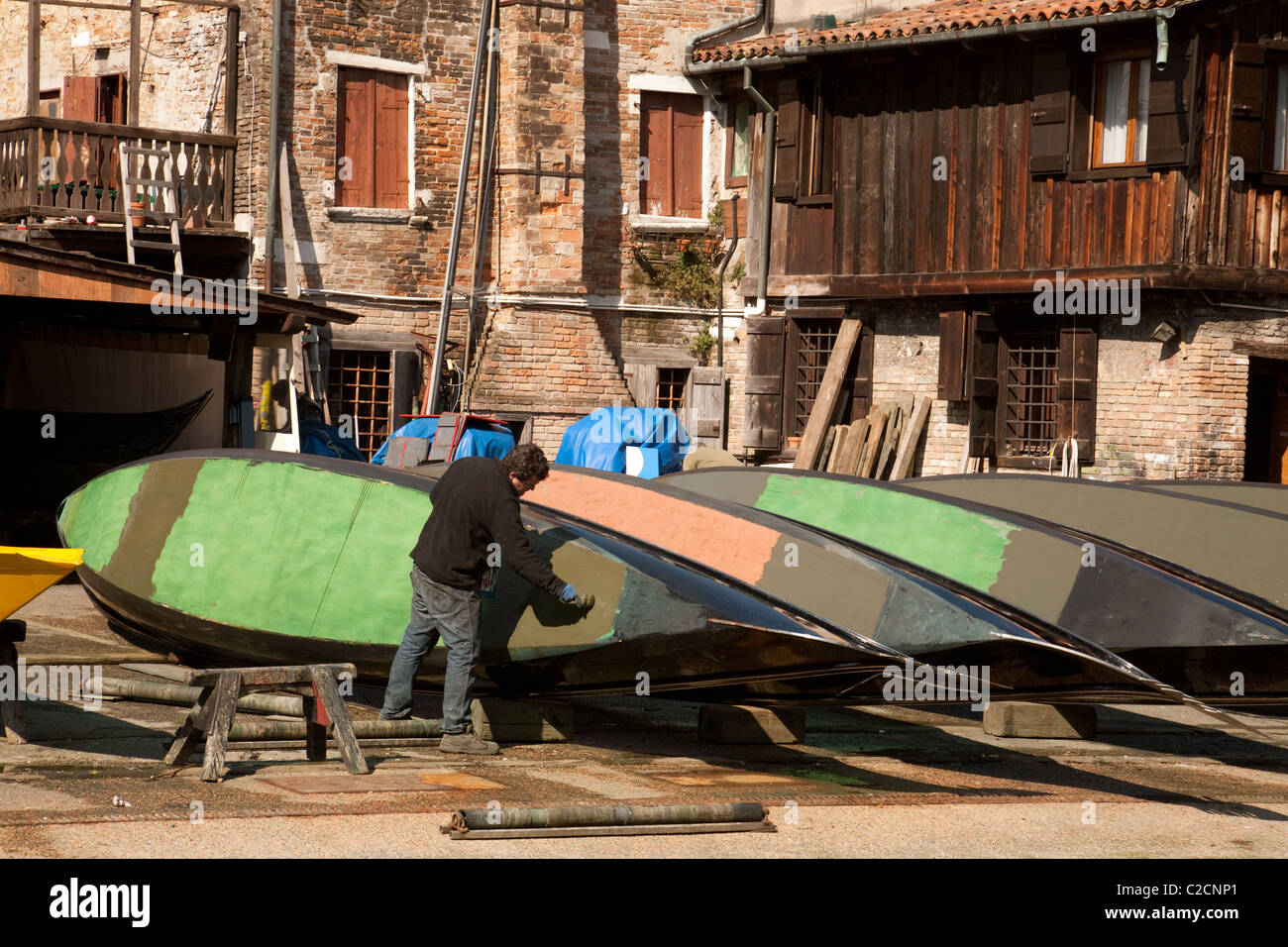 A gondola being repaired in a boatyard, Venice, Italy - Stock Image