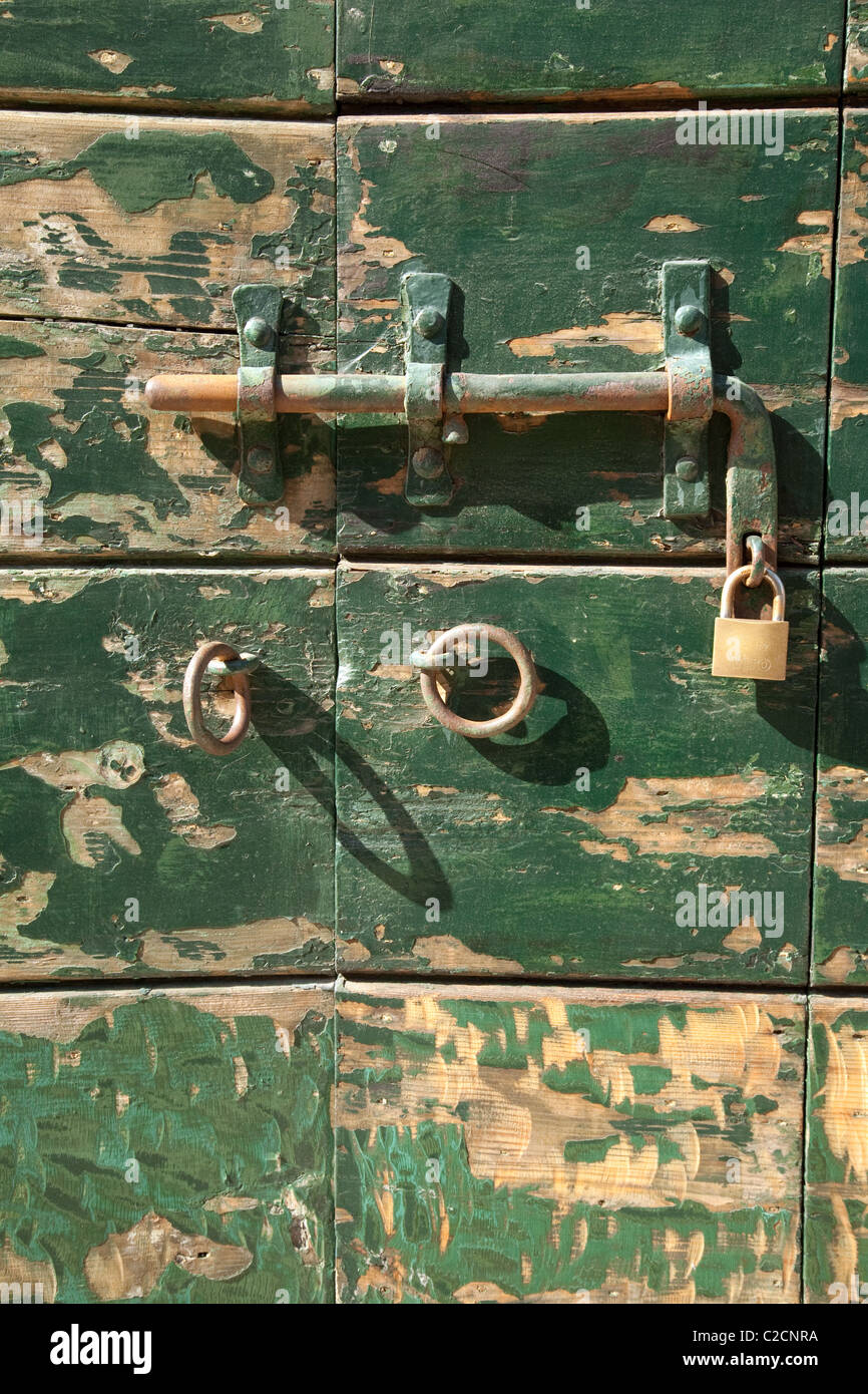 Bolt and lock on a green door, Venice, Italy - Stock Image