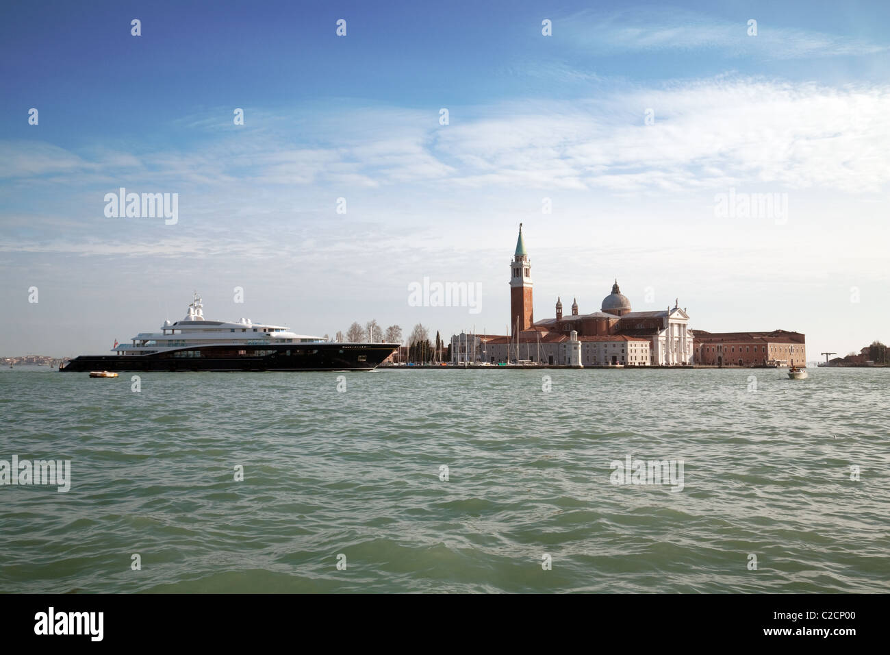An expensive yacht passes the Lido, Venice Italy - Stock Image
