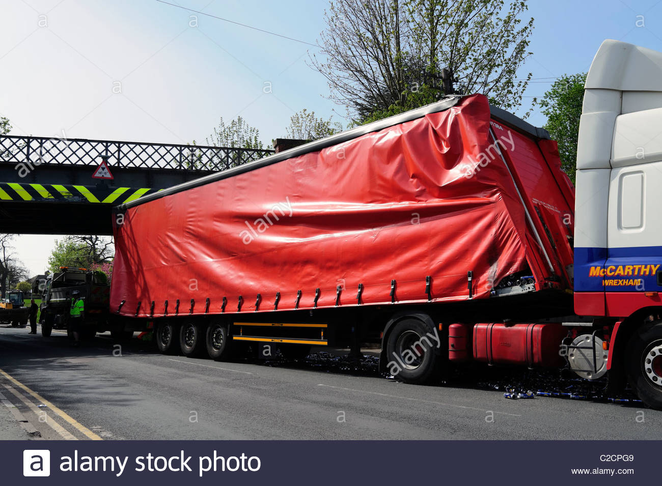 HGV lorry crash in to a low bridge shedding its load from the trailer, Hereford, UK. Truck crashed into low bridge. - Stock Image