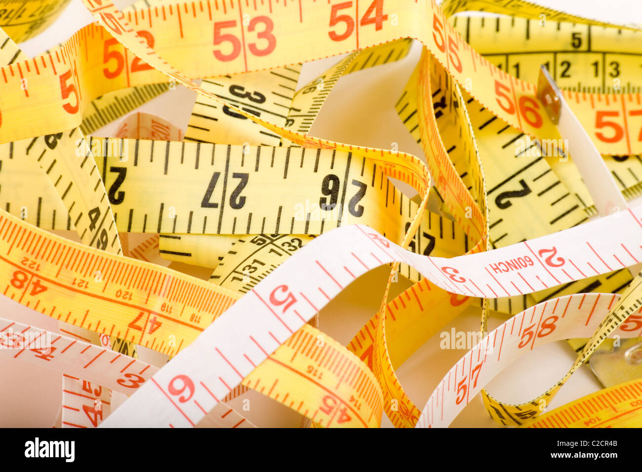 Tape Measure with white background - Stock Image