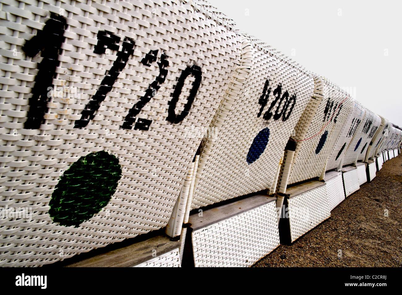 beach chairs at the end of season; sylt off-season; Strandkörbe am Ende der Saison - Stock Image