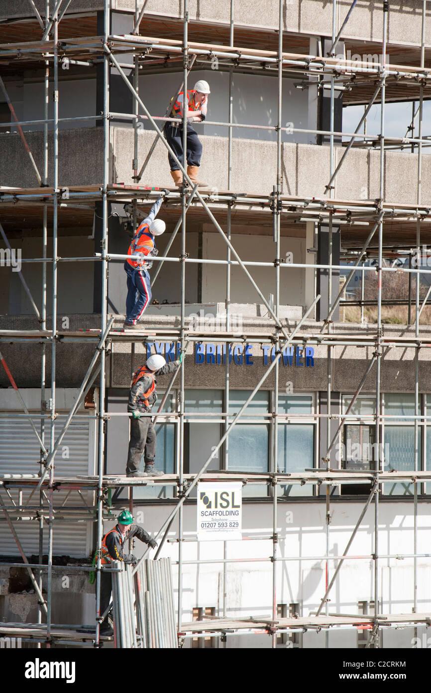 Scaffolders working on a building in Gateshead, Tyneside, UK. - Stock Image