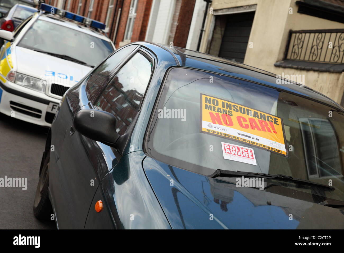Police seize an uninsured car on a street in Nottingham, England, U.K. - Stock Image