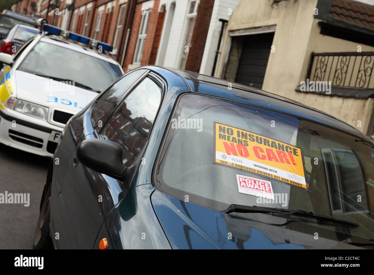 Police seize an uninsured car on a street in Nottingham, England, U.K. - Stock Image
