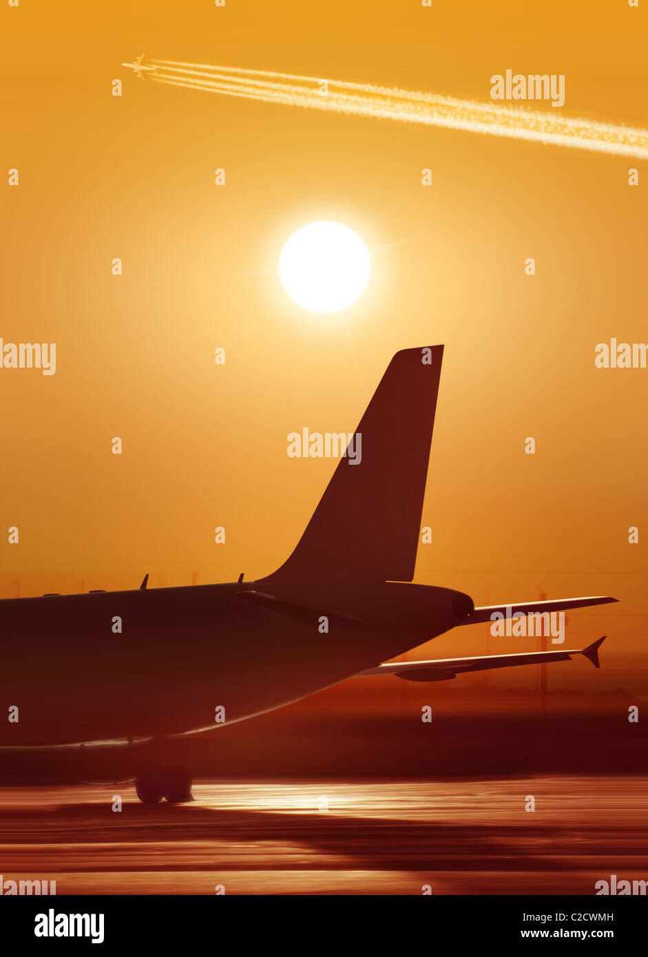 big passenger airplane is waiting for departure in airport, sunset - Stock Image