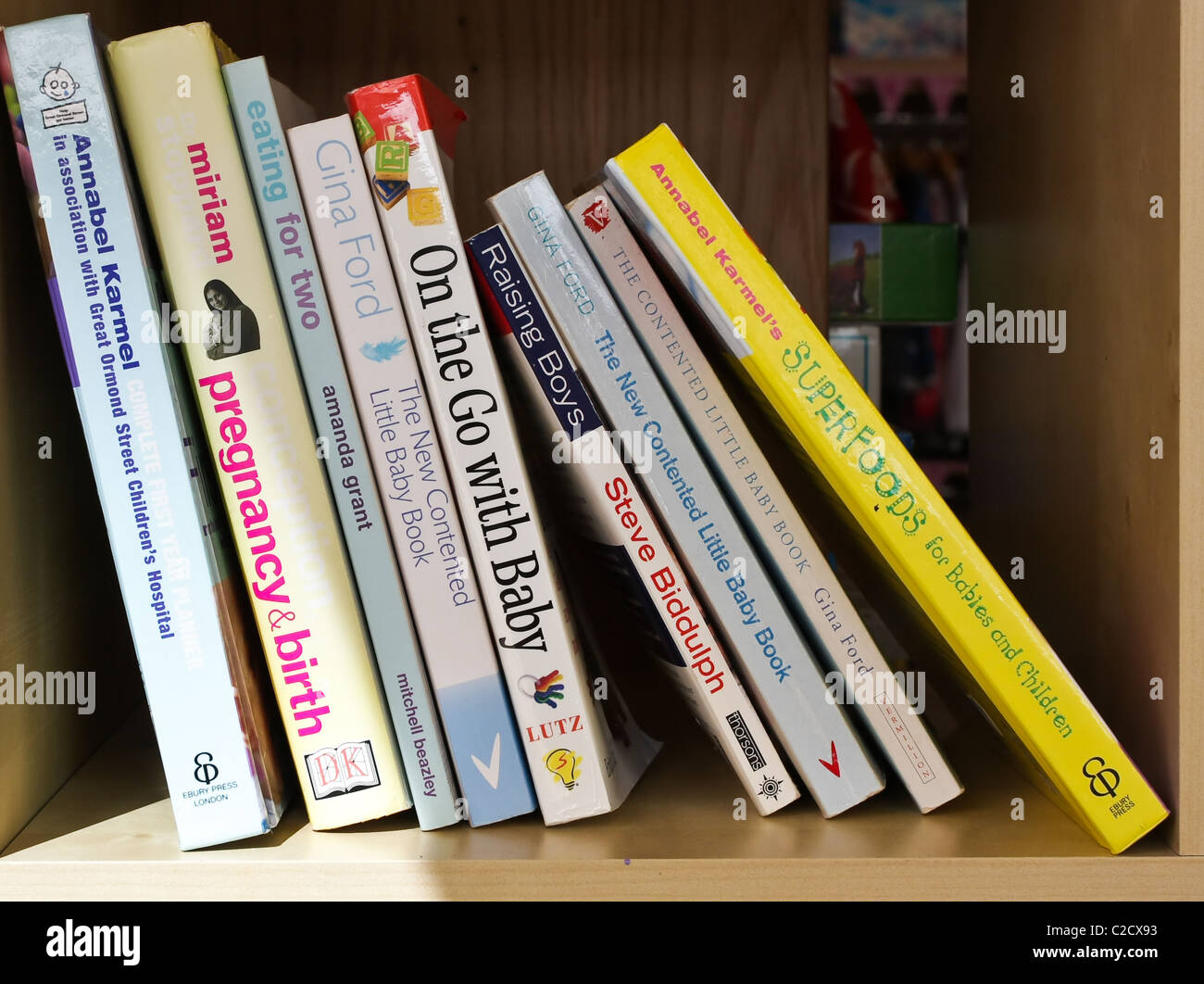 Selection of books on raising children - Stock Image
