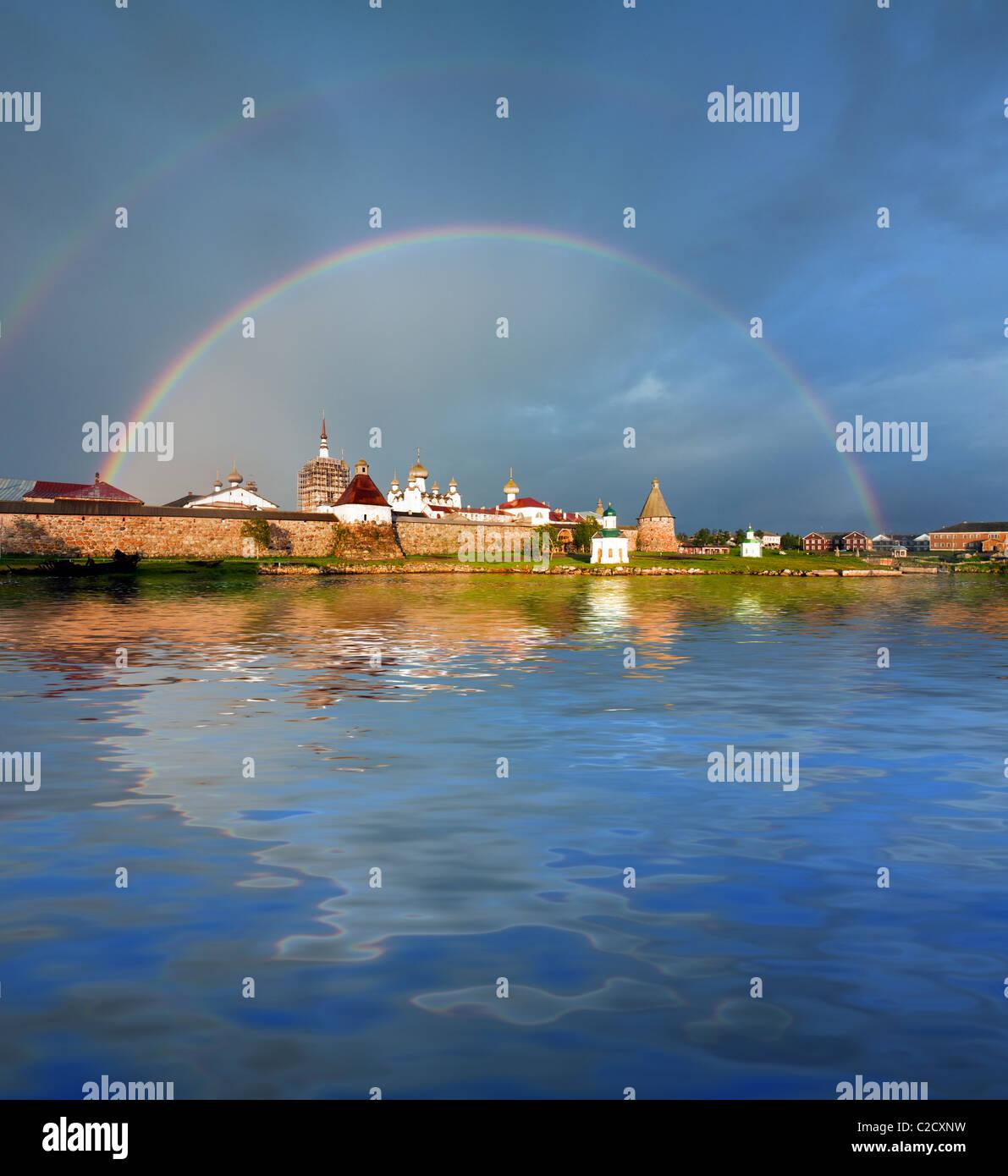 Rainbow over the Monastery. Stock Photo