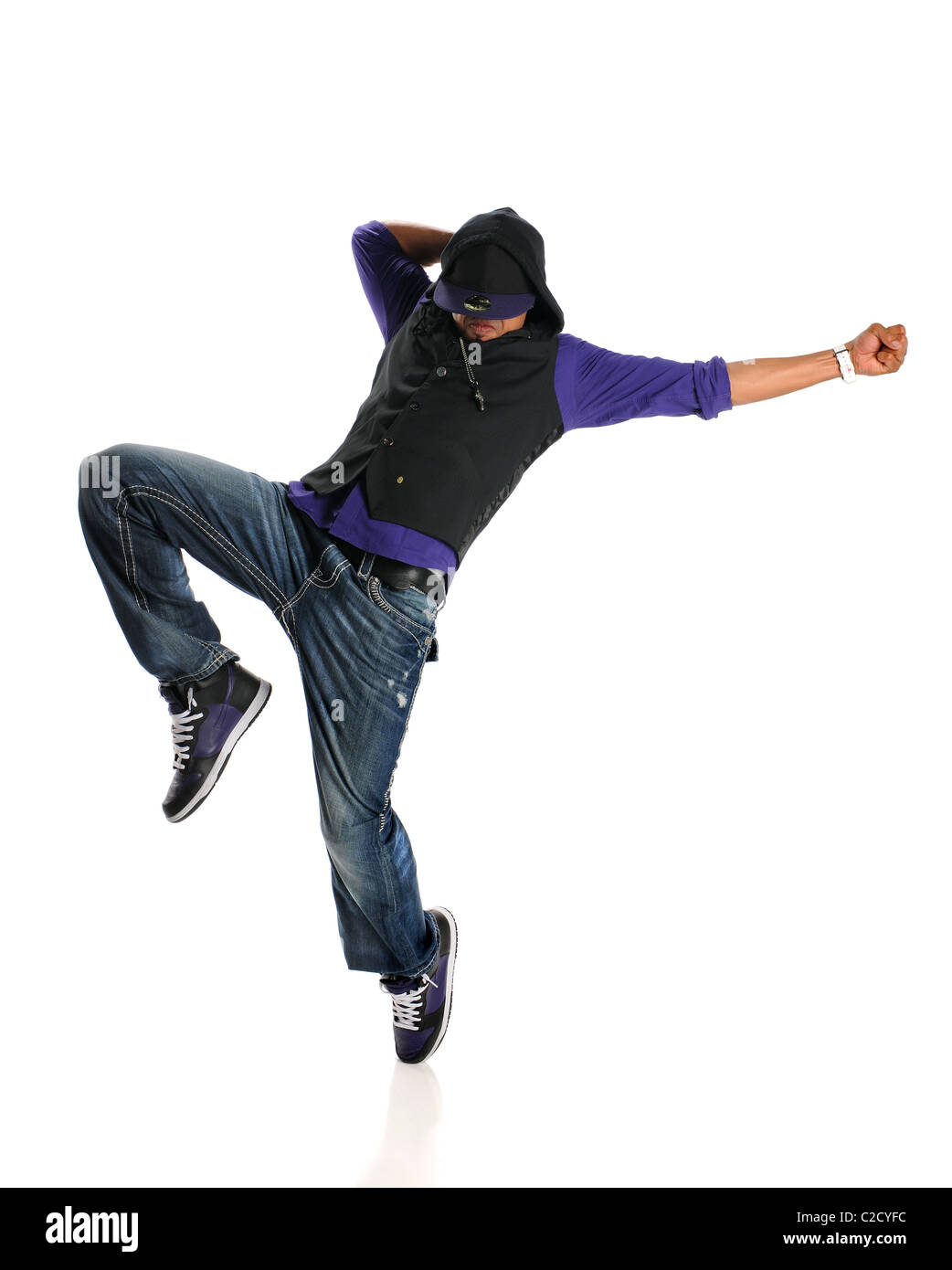 Hip Hop style dancer performing isolated over white background - Stock Image