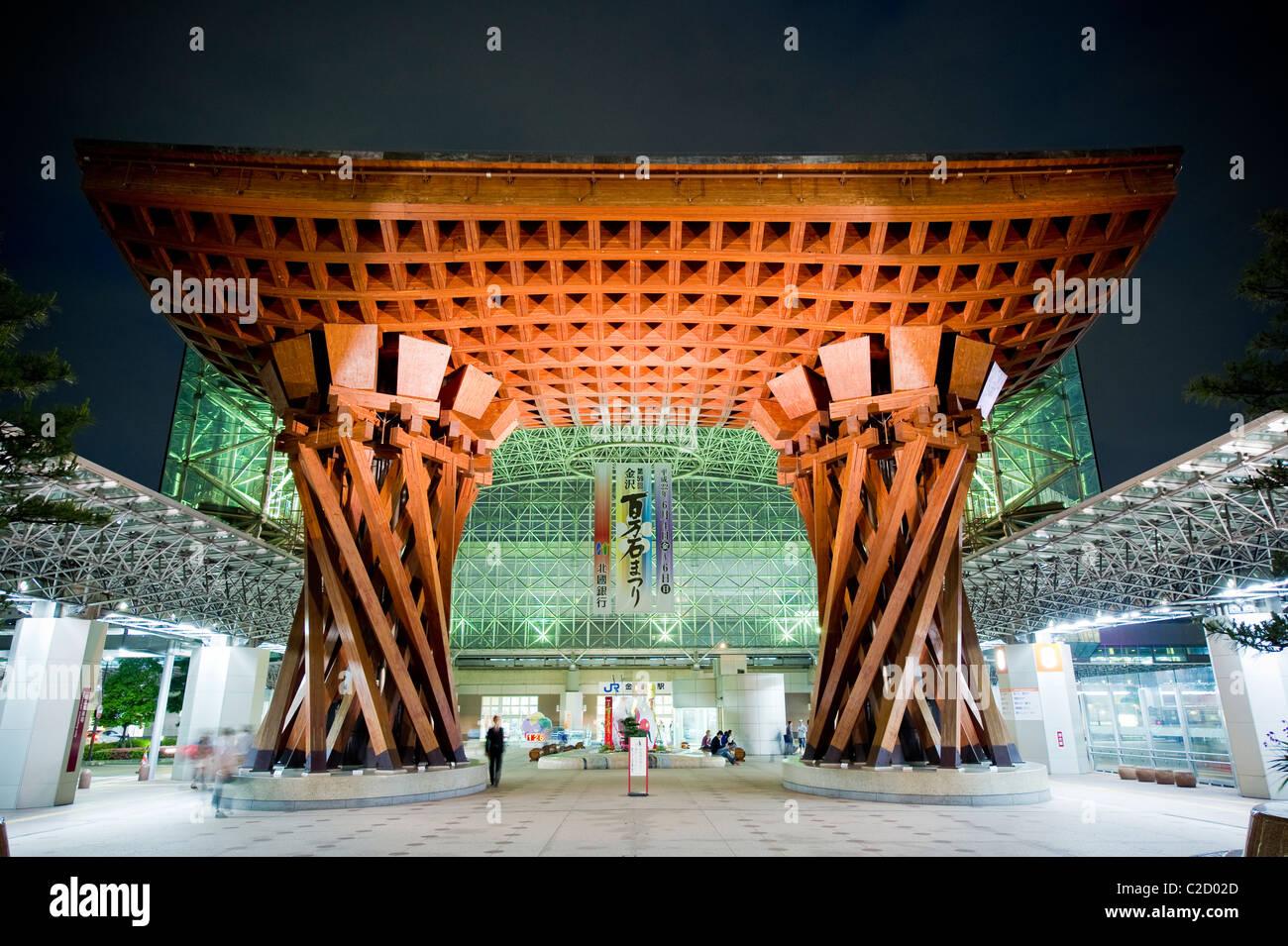 The Tsuzumi (drum) Gate at Kanazawa Station at dusk - Stock Image