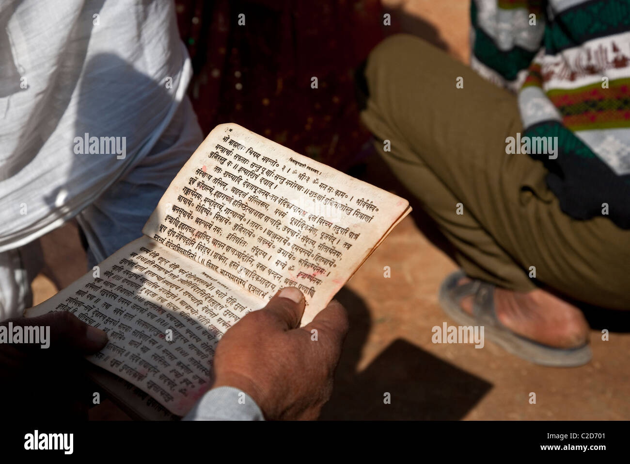 Man reading a text written in Nepali. Kathmandu. Nepal - Stock Image