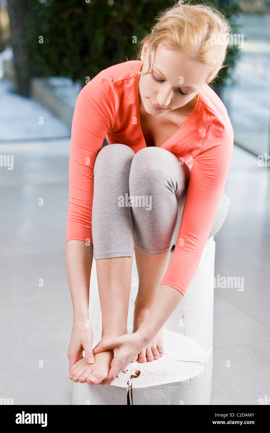 Young woman massaging feet Stock Photo