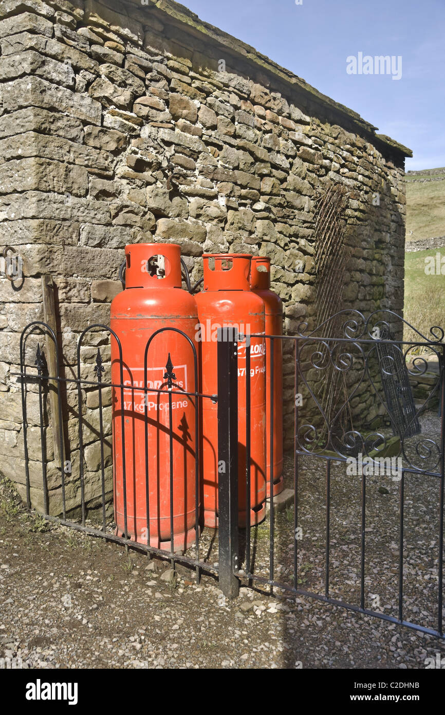 Propane Gas bottles outside a house in Upper Swaledale in the Yorkshire Dales. UK. - Stock Image