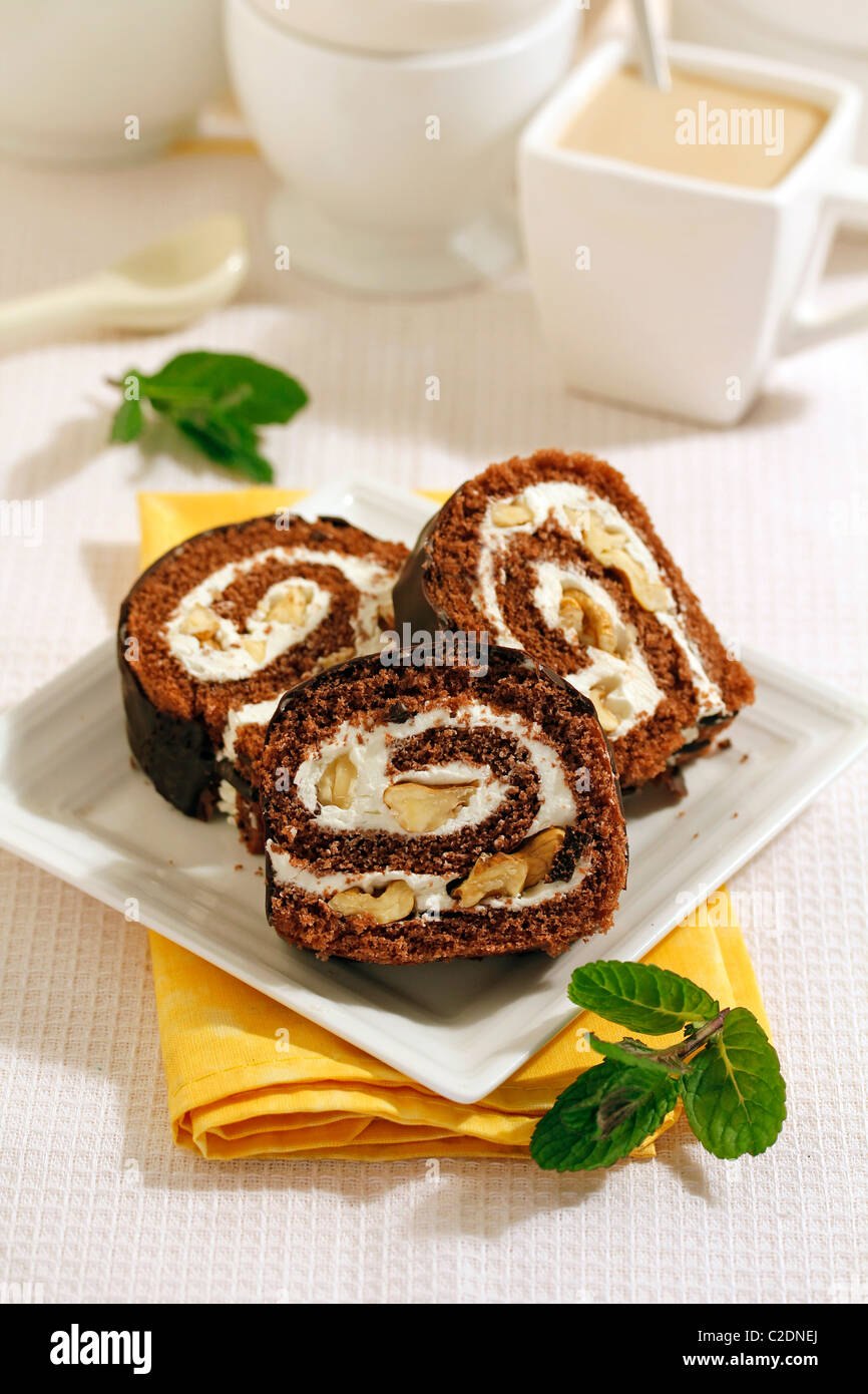 Chocolate Swiss roll with walnuts. Recipe available. Stock Photo