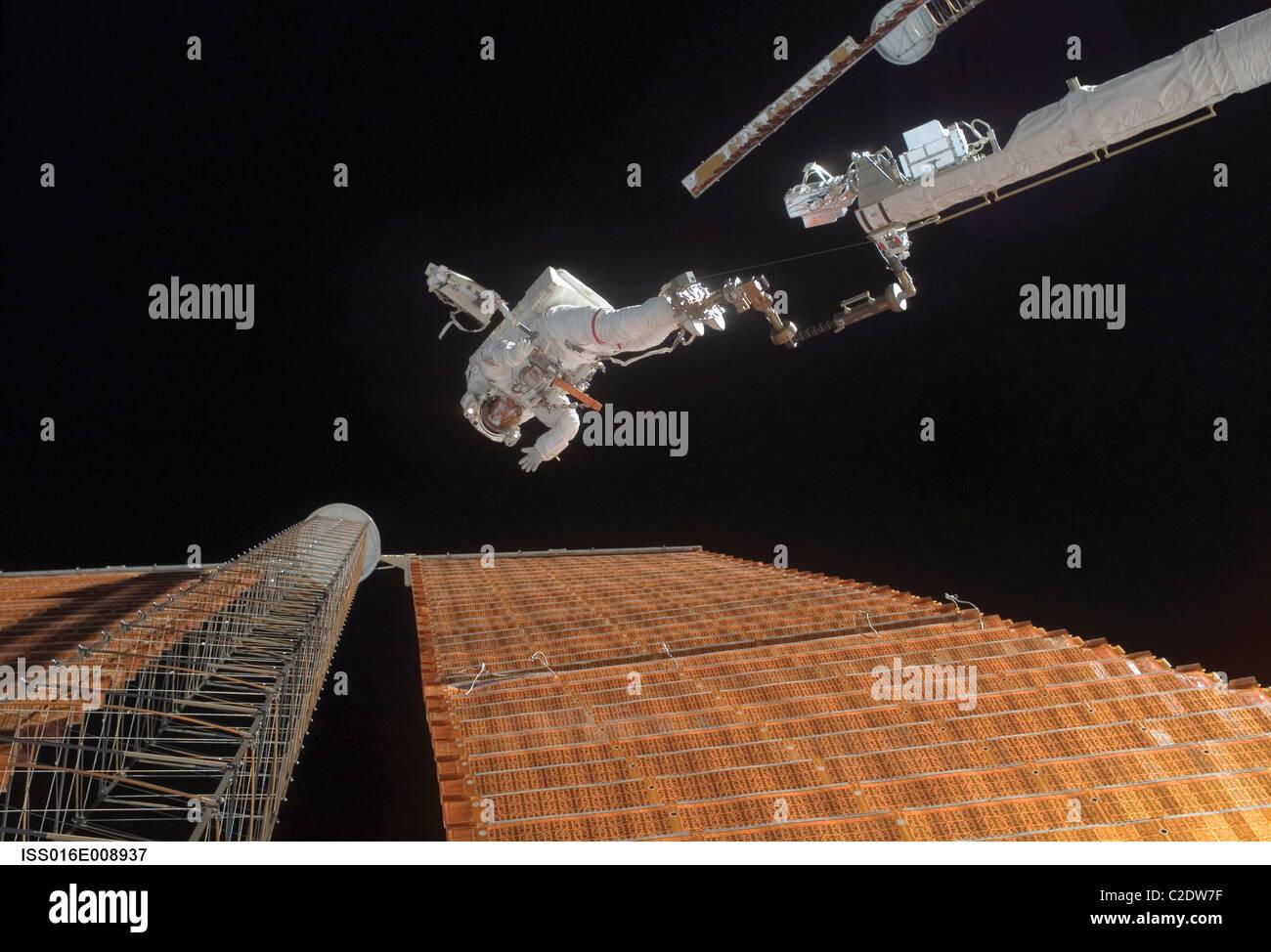 Astronaut participates in extravehicular activity - Stock Image