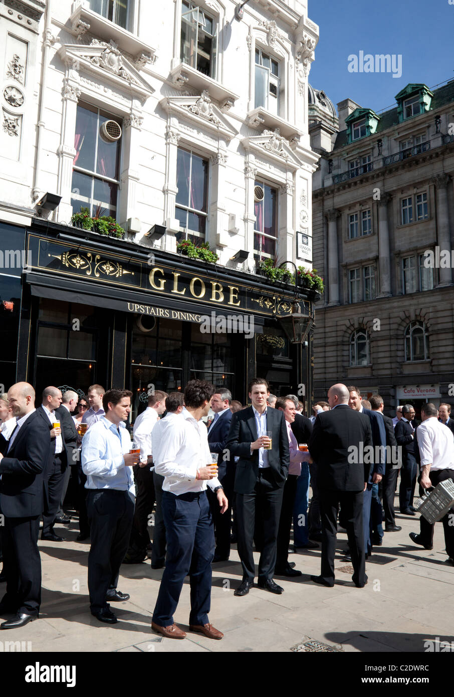 City workers drinking at lunchtime outside pub, London Stock Photo