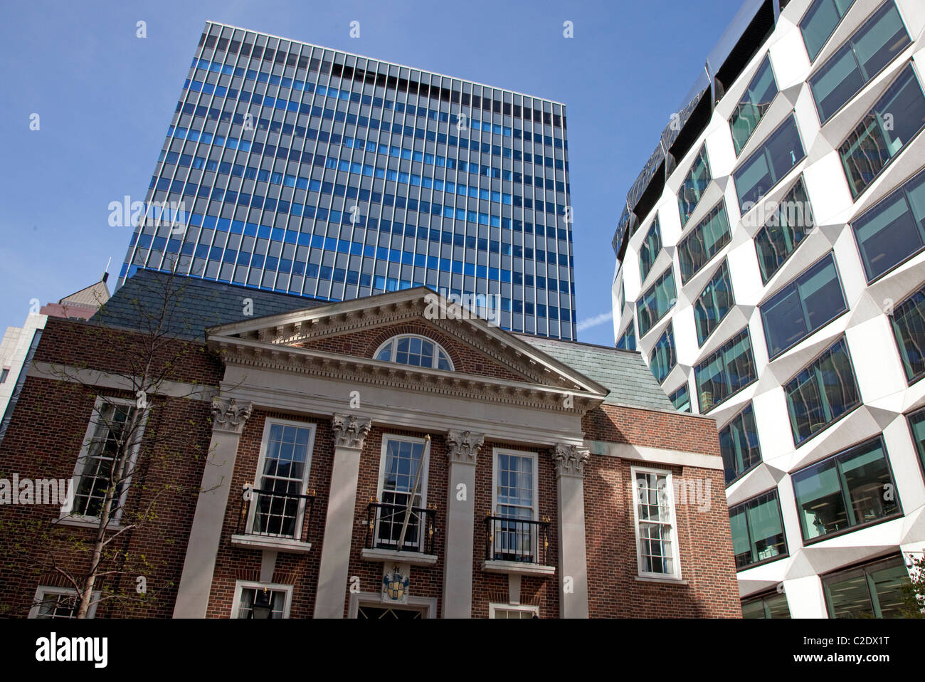 Contrasting architecture in City of London: Girdlers' Hall in foreground - Stock Image