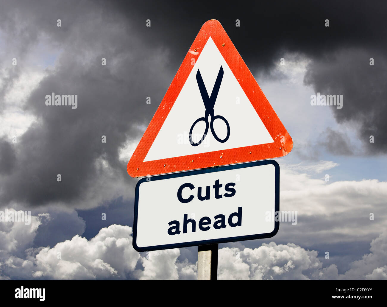 Cuts ahead concept UK against a stormy sky - Stock Image