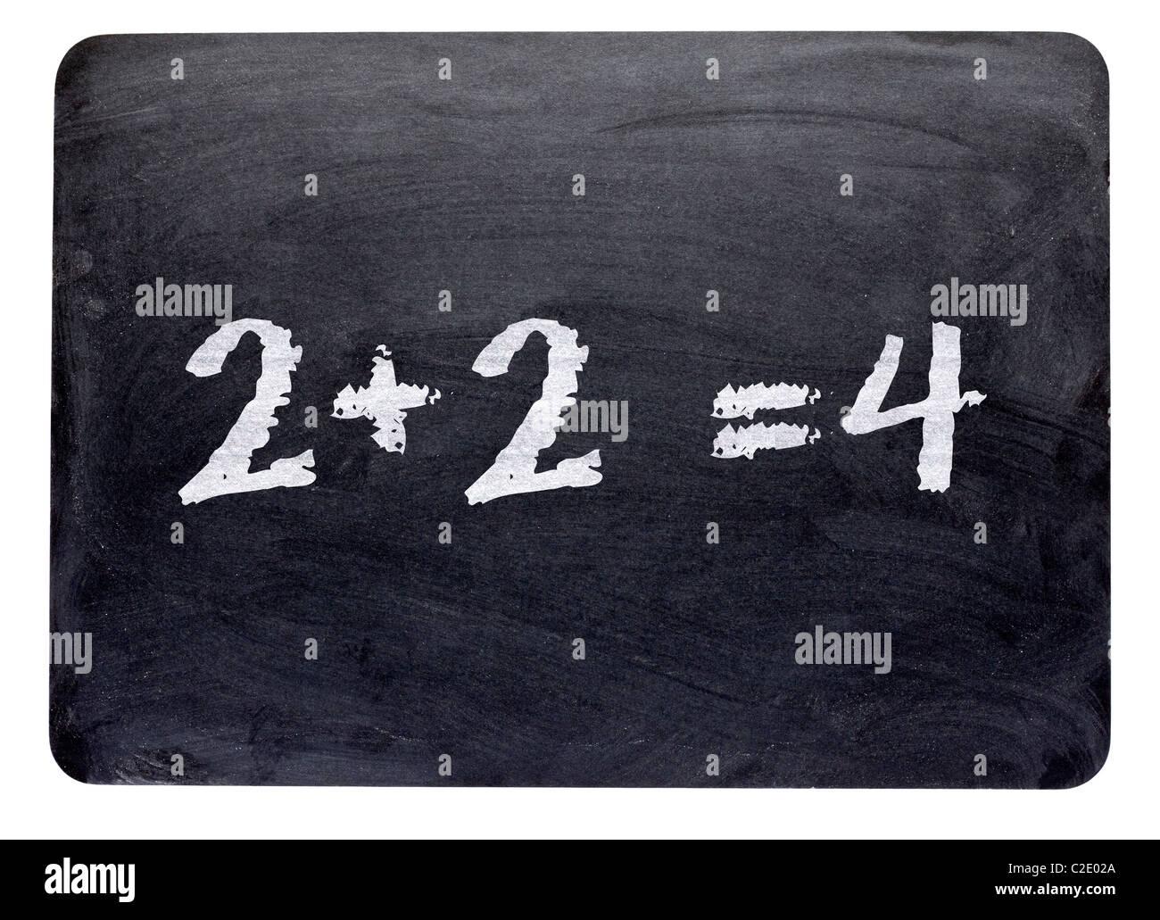 Simple mathematics sum written on a blackboard close up - Stock Image