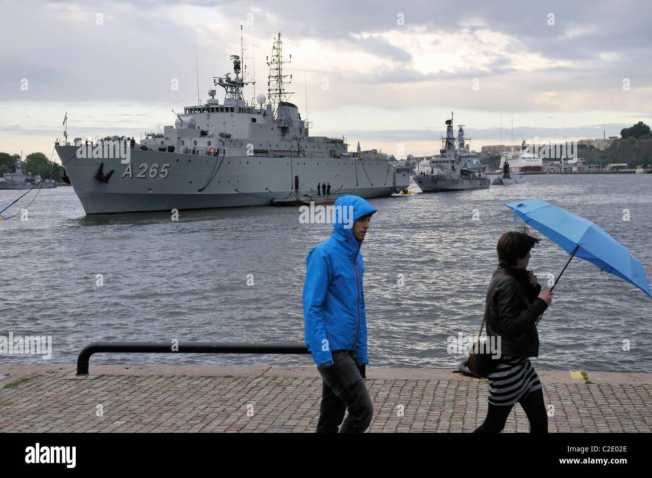Battleships of the Swedish Navy and pedestrians at the harbor of Stockholm, Stockholms Lan, Sweden - Stock Image
