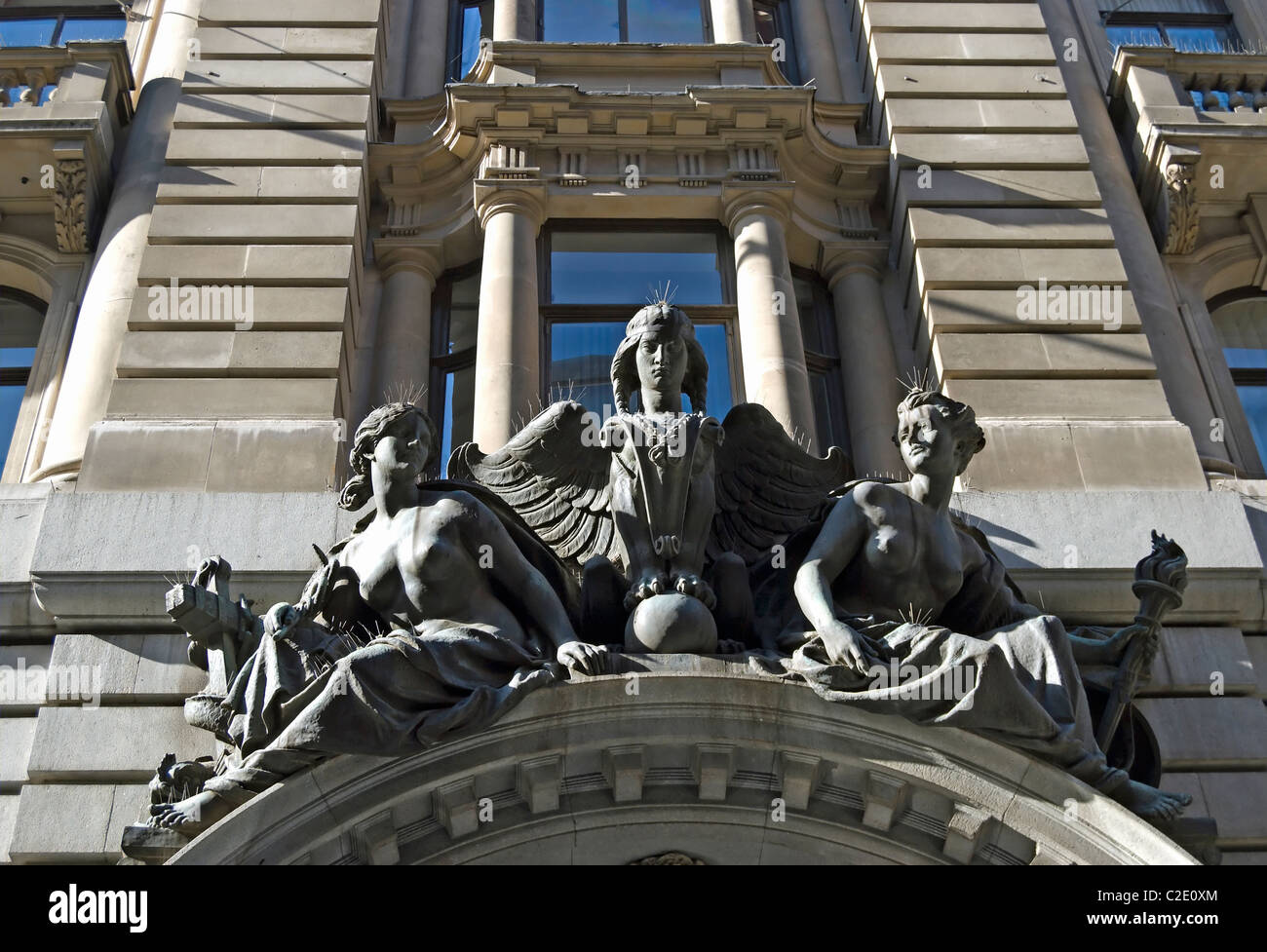 statuary above entrance to the 1910 royal insurance buildings, on lombard street in the city of london, england - Stock Image
