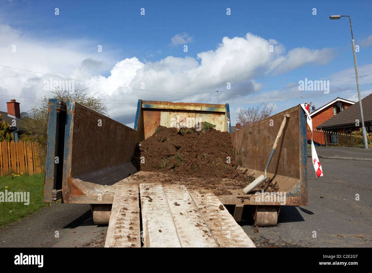 large roll on off building skip placed on a street in the uk - Stock Image