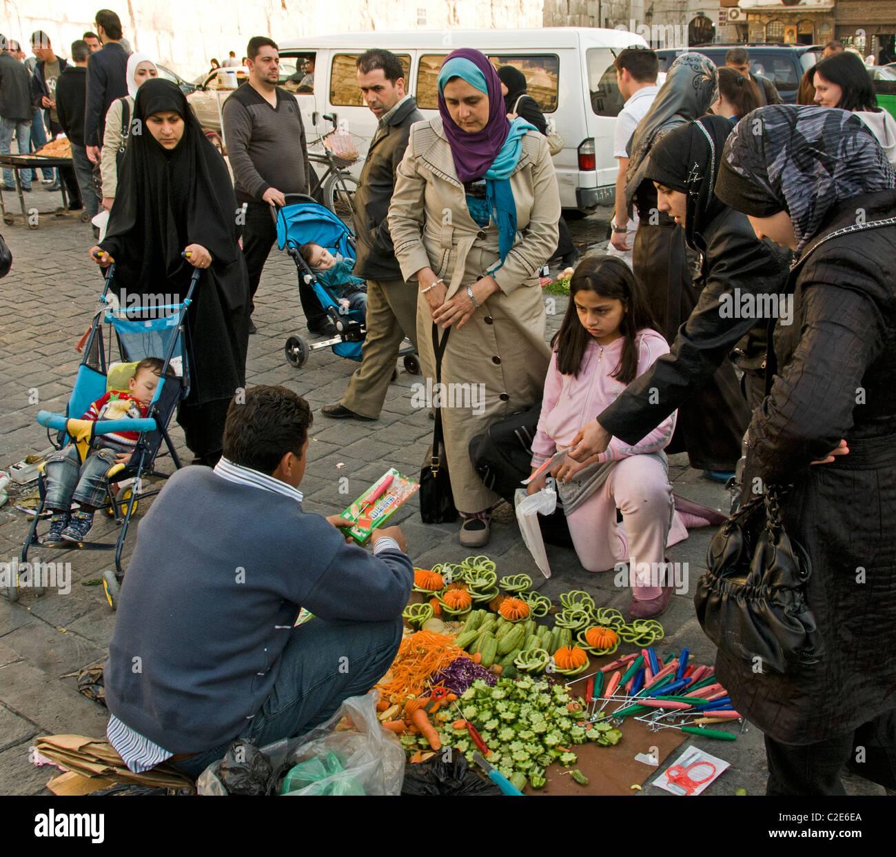 Damascus Syria Bazaar kitchen cutter vegetables fruit knife  Souq market - Stock Image