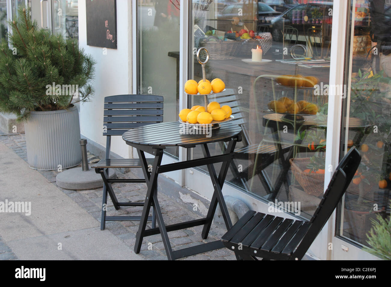 A café table in posh Østerbro district in Copenhagen, Denmark - Stock Image