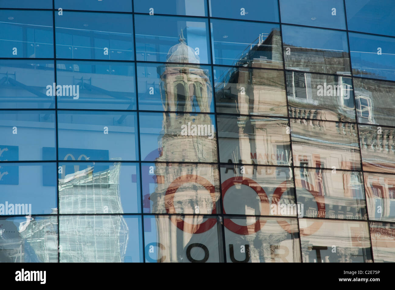 The  Royal Exchange Building and Number One Deansgate reflected in glass window of the Arndale,Manchester,UK. - Stock Image
