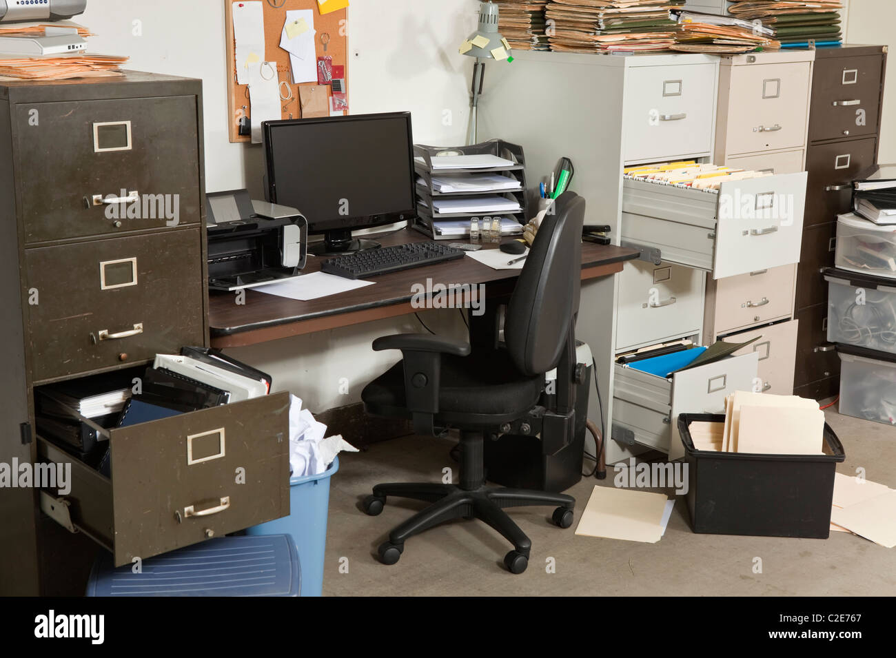 Very messy office with piles of files. - Stock Image