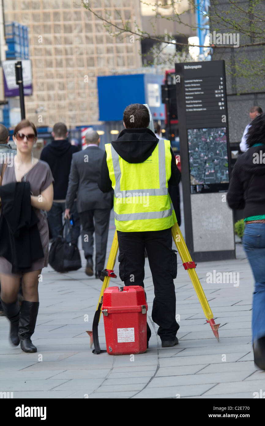 Surveyor using theodolite central london - Stock Image
