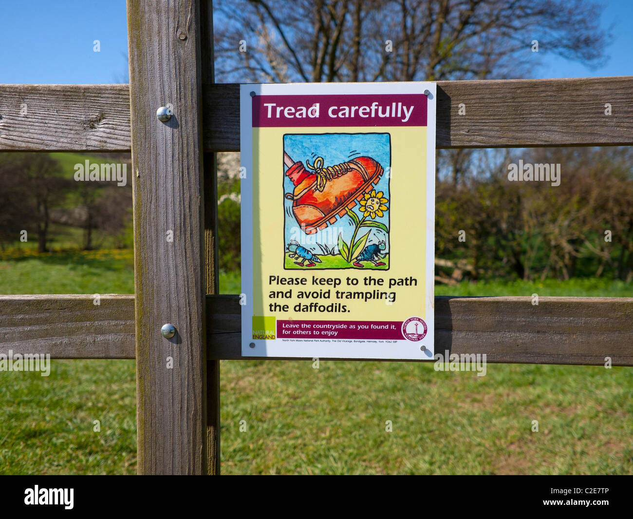 Tread carefully to avoid trampling the daffodils sign on the Farndale walk famous in spring for daffodils - Stock Image