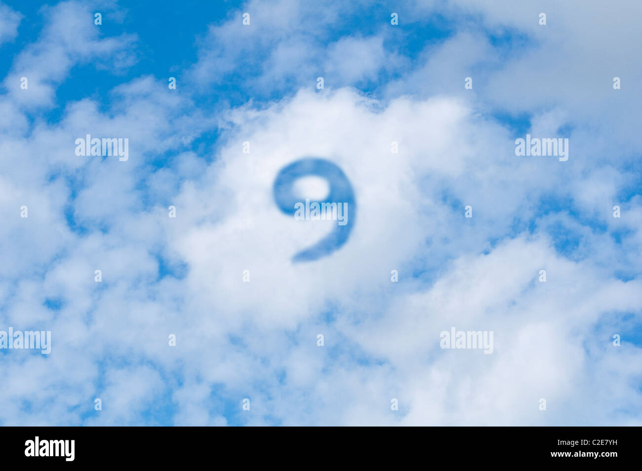 Cloud 9  - white clouds with blue sky and the number nine. - Stock Image