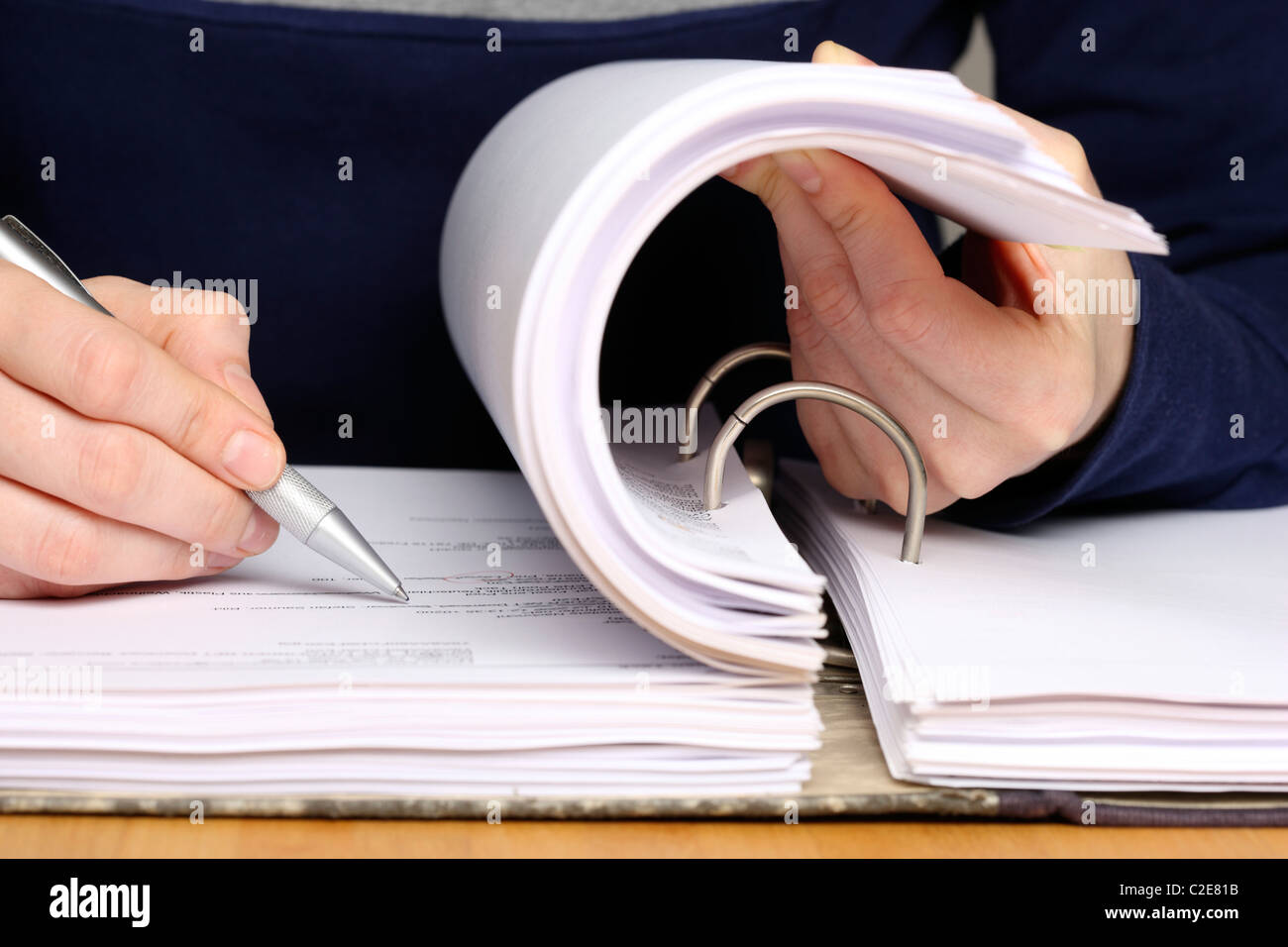 Office, files, person looks through a document file. Stock Photo