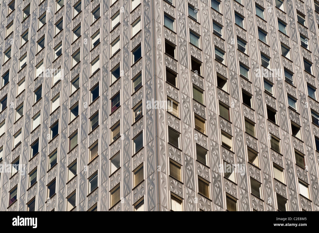 Steel, stainless, self cleaning geometrical pattern facade of Mobil Building, Manhattan, New York City, USA - Stock Image