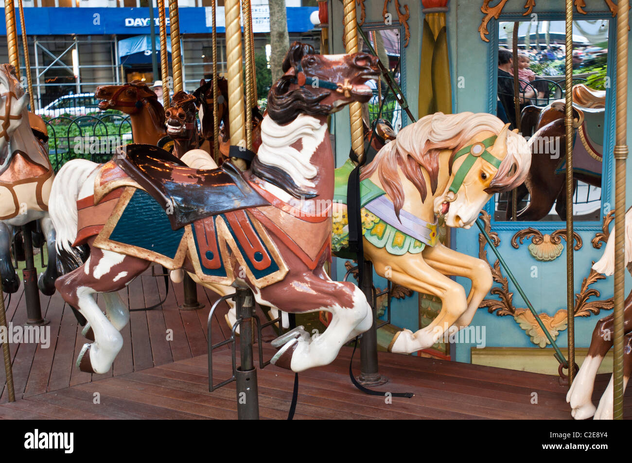 Well crafted horses at Le Carrousel in Bryant Park, Manhattan, New York City, USA - Stock Image