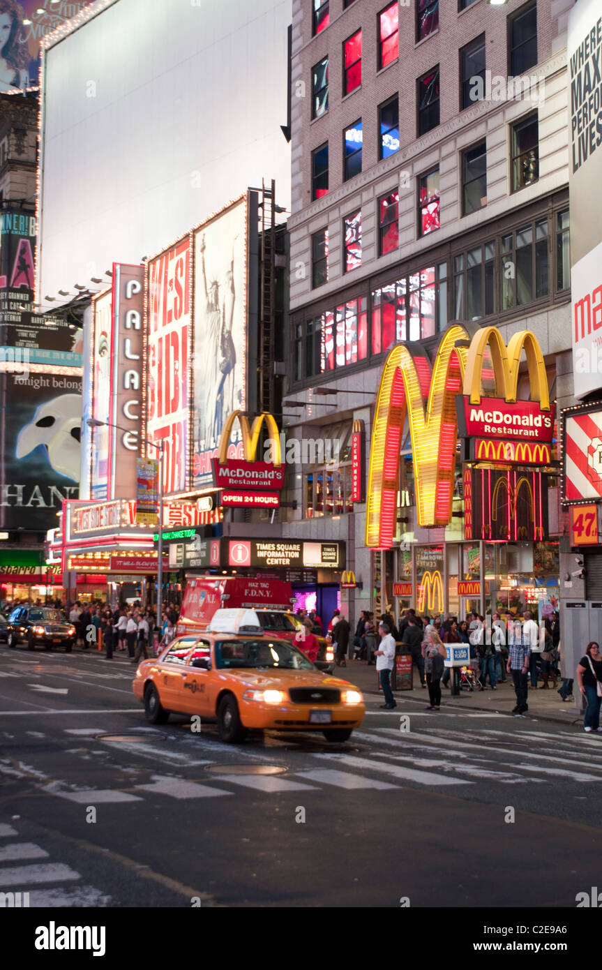 Yellow taxi cab and McDonald's restaurant at Times Square, Manhattan, New York City, USA - Stock Image
