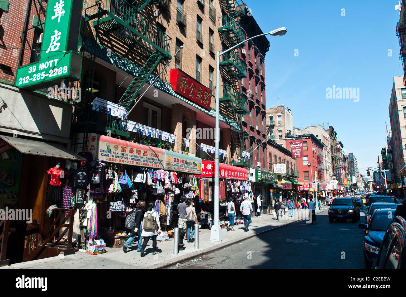 Busy street with shops and Chinese script signs, Chinatown, Manhattan, New York City, USA - Stock Image