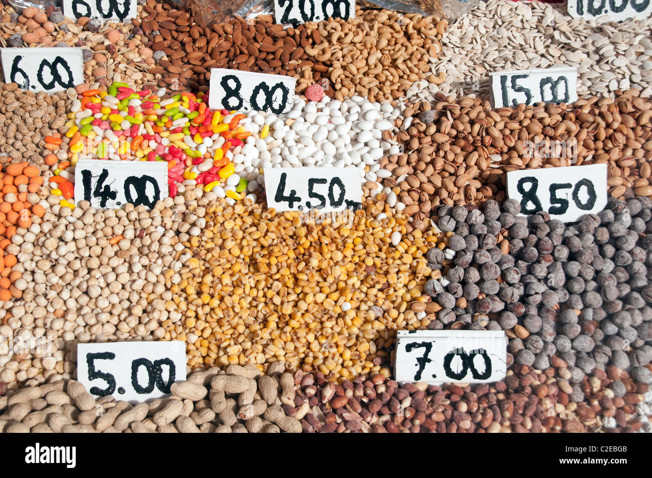 A variety of mixed nuts in a store shop window in the Kurdish city of Van in the southeast Anatolia district of - Stock Image