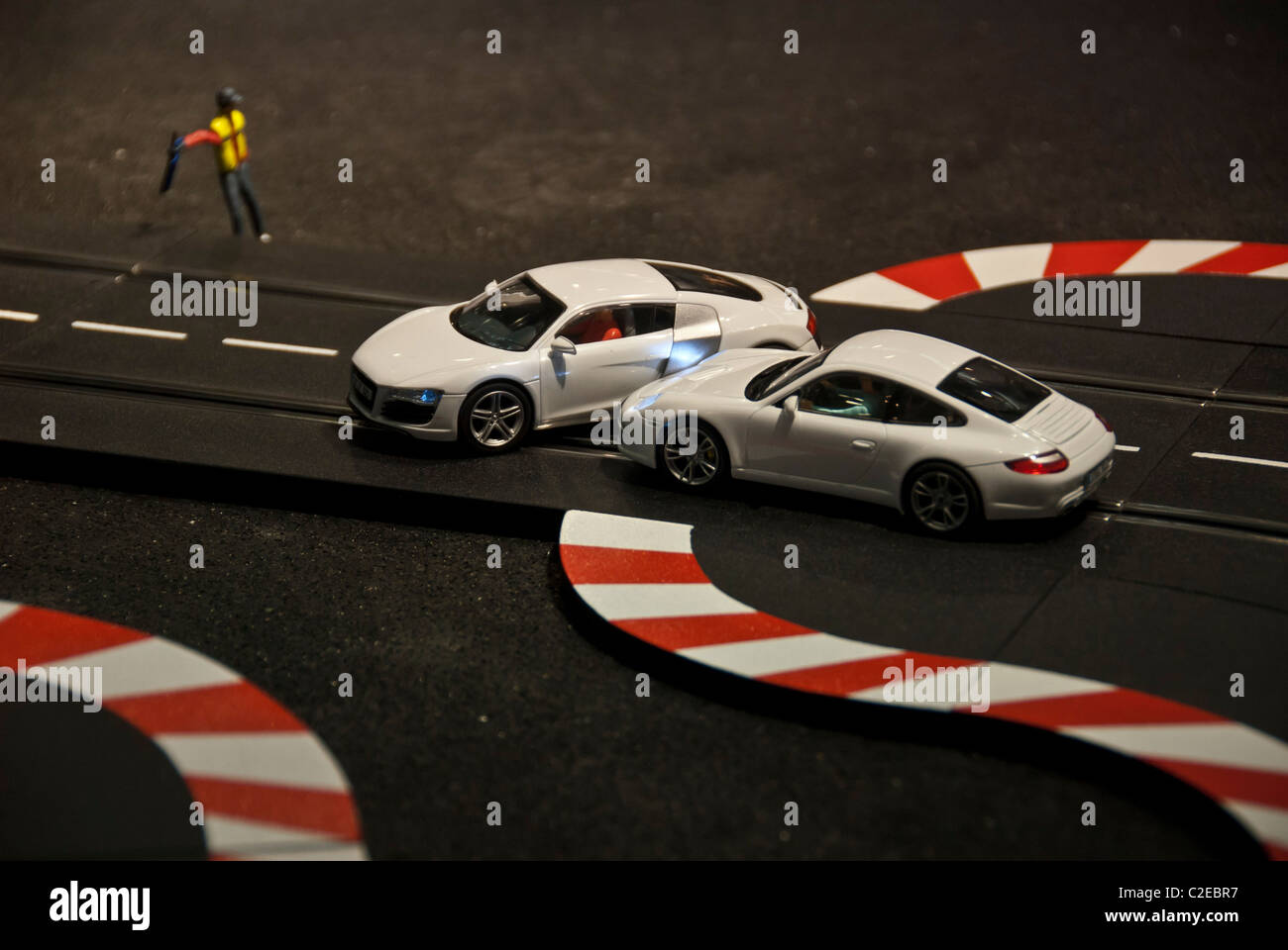 Car accident in a model racetrack. Two race cars crash during a ...
