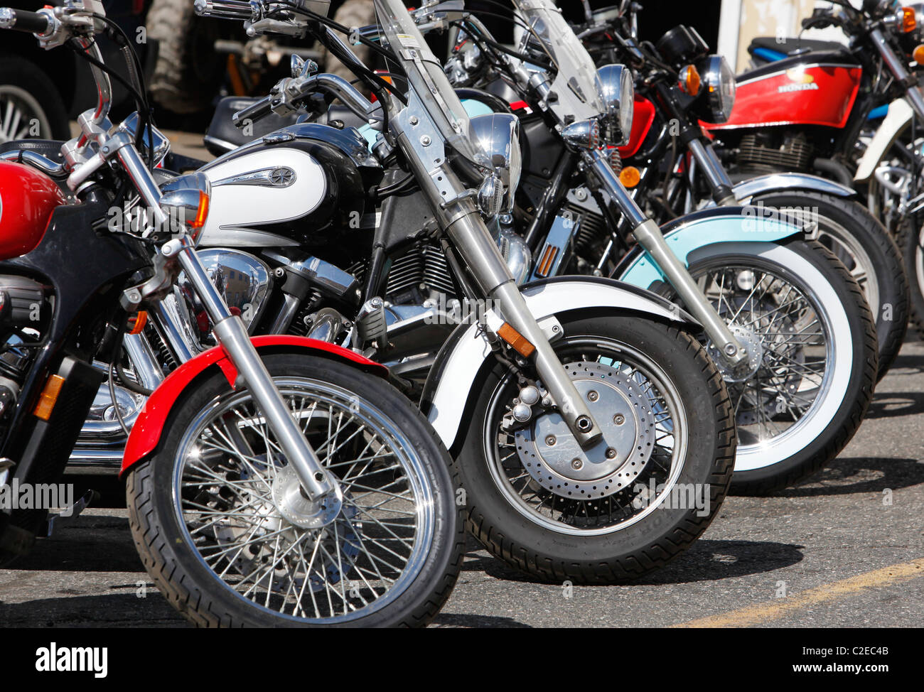 A row of parked motorcycles - Stock Image