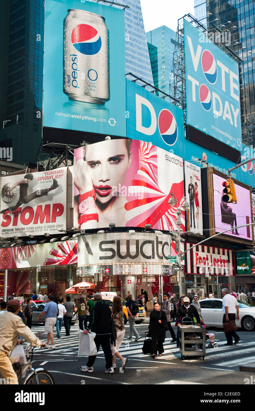 Swatch store at Times Square with big advertisements of Pepsi Cola, Manhattan, New York City, USA - Stock Image