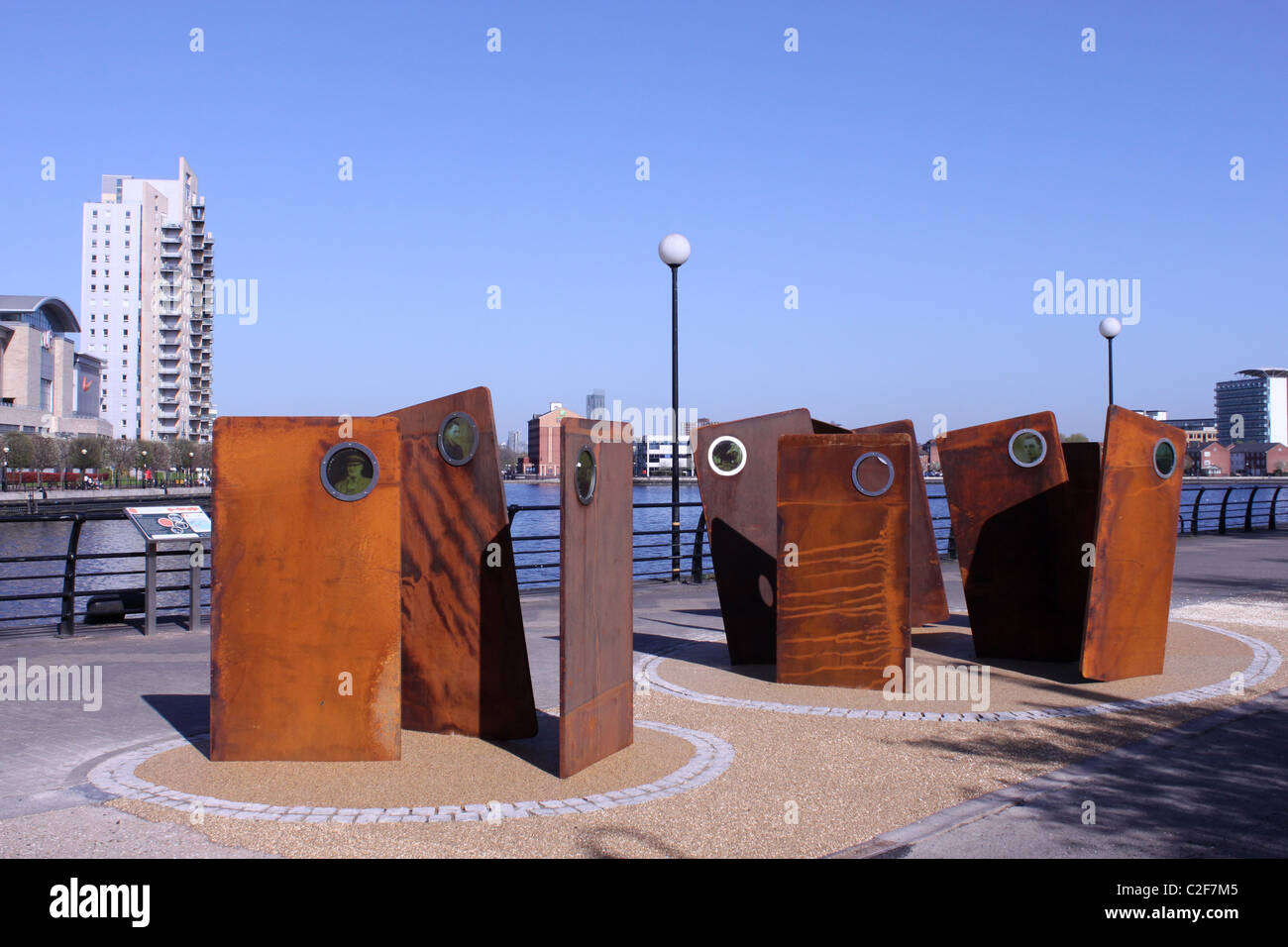 Casuals by Broadbent, a sculpture at Salford Quays, Manchester which is part of the unlocking Salford Quays Heritage - Stock Image